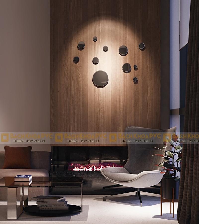Có tấm ốp tường giả gỗ trang trí phòng khách đơn giản mà ấm cúng hợp không gian mọi ngôi nhà Việt